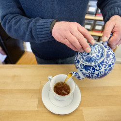 Tea Maineia co-owner Dan Holmes pours a cup of freshly brewed Wild Blueberry tea at his shop on Maine Street in Winterport.