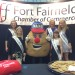 Spuddy is flanked by the Maine Potato Queens at the Northern Maine Agri-Business Trade Fair.