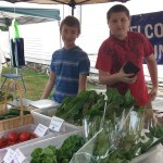 First Work students manage a farmstand at the Oceanview Grange