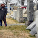 Judy Pogachefsky looks at headstones pushed off their bases by vandals in the Mount Carmel Cemetery, a Jewish cemetery, in Philadelphia, Pennsylvania, Feb. 27, 2017.