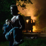 "Logan/Wolverine (Hugh Jackman) tries to protect the young mutant Laura (Dafne Keen) in ""Logan."""