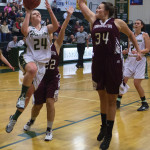Husson University's Chandler Guerrette goes up for two past University of Maine at Farmington's Elizabeth Ferry during a 2015 game at Newman Gymnasium in Bangor.