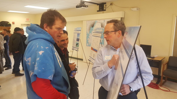 Chris Chadwick (left) of St. George speaks with Dick Hall of SGC Engineering about plans for an offshore wind site that's likely to send energy to the mainland through an underwater cable that's expected to come to shore in St. George.