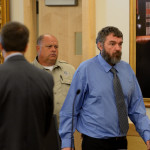 Anthony Lord (right) enters a courtroom for his first appearance before Justice Ann Murray on Sept. 14, 2015, at the Penobscot Judicial Center in Bangor. Lord is accused of fatally shooting two men and injuring four others in a July rampage that lasted 18 hours.
