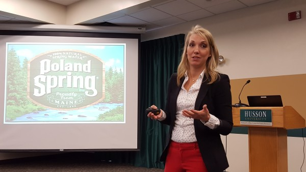 Poland Spring Community Relations Manager Heather Printup talks about the bottled water company's planned expansion efforts during a March 1 presentation at Husson University.