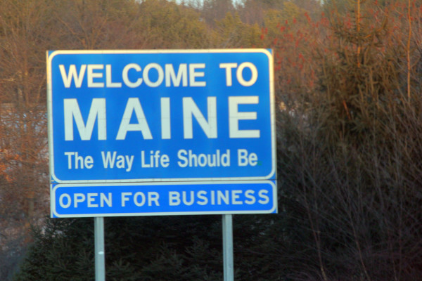A roadside sign welcomes visitors to Maine. The national magazine U.S. News & World Report says Maine is the most equal state in the nation.