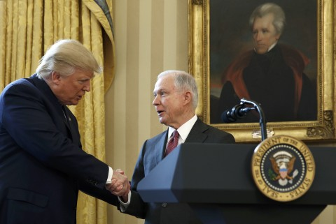 President Donald Trump congratulates Jeff Sessions after he was sworn in as U.S. attorney general during a ceremony in the Oval Office, Feb. 9, 2017.