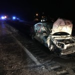 Snow and ice on a stretch of Interstate 95 Thursday night caused a rash of crashes, including this one, which set the car ablaze. The driver escaped without injury, according to Maine State Police.