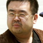North Korean heir-apparent Kim Jong Nam takes a look around as he boards a plane upon his deportation from Japan at Tokyo's Narita international airport May 4, 2001.