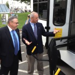 Gov. Paul LePage takes a look at a refurbished bus with Tim McCabe, director of Business Development for Maine Military Authority, in a 2013 photo.