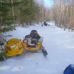 The snowmobile driven by Thomas Henderson, 28, from Dixfield, shows damage sustained when he apparently lost control of the sled and went into some trees. Henderson was pronounced dead at the scene, the state's eighth snowmobiling fatality this winter.