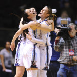 University of Maine teammates Naira Caceres (left), Laia Sole (obscured) and Anita Kelava celebrate on Saturday after the Black Bears beat Binghamton 57-40 in the America East quarterfinals at the America East tournament in Portland.