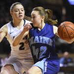 The University of Maine's Sigi Koizar drives to the basket against the University of New Hampshire's Brittni Lai during their America East semifinal at the Cross Insurance Arena in Portland on Sunday.