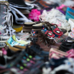A table overflows with children's shoes at a 2016 yard sale in Orrington.