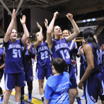 Members of the University of Maine basketball team, including (from left) Sheraton Jones, Fanny Wadling, Blanca Millan, Laia Sole, Sheraton Jones and Julie Brosseau, thank the crowd at the Cross Insurance Arena in Portland after beating New Hampshire in the America East semifinals on Sunday.
