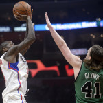 Los Angeles Clippers guard Jamal Crawford (11) shoots over Boston's Kelly Olynyk (41) during the first half of Monday night's NBA game at Staples Center in Los Angeles. The Clippers won 116-102.