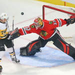Chicago goalie Scott Darling (right) makes a save on Pittsburgh's Patric Hornqvist during at March 1 at the United Center in Chicago. The former UMaine goaltender is sidelined with an upper-body injury.