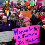 Michelle Robbins (center) cheers during the Women's March on Maine outside the Burton M. Cross building at the Maine State House in Augusta on Jan. 21.