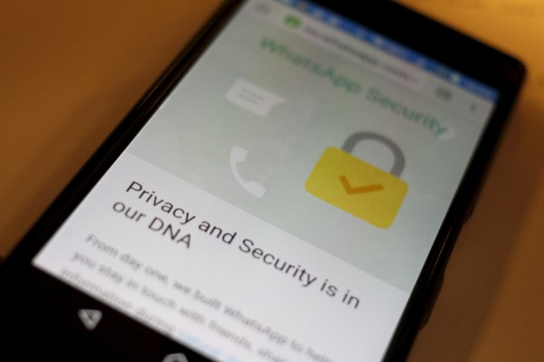 A security message is seen on a Whatsapp screen in this illustration photo. The app is one way to protect conversations users want to keep private.