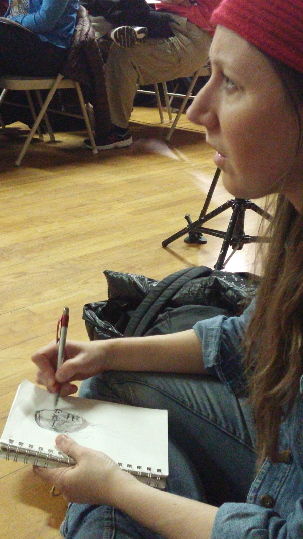 Julia Durgee of Portland draws a sketch of Gov. Paul LePage during his town hall meeting Wednesday at the AMVETS hall in Yarmouth.