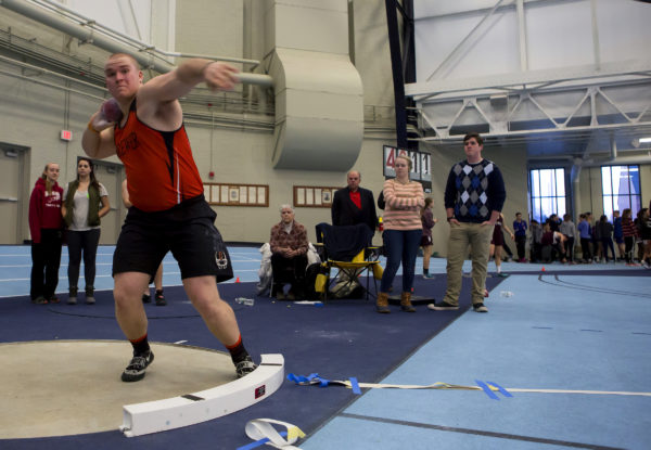Austin Lufkin of Brewer High School, pictured throwing the shot put at the PVC-Eastern Maine Indoor Track League Championships last month, is among three eastern Maine athletes competing this weekend at the New Balance Indoor Nationals meet in New York City.