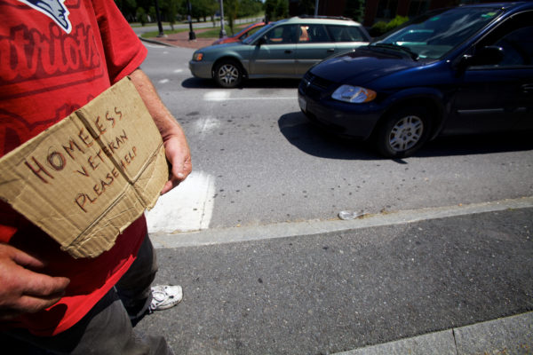 A man panhandles on the corner of Franklin and Somerset streets in Portland in 2013.