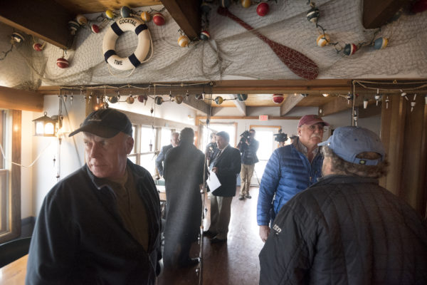 People gather for the auction of the Lobster Pound restaurant in Lincolnville Thursday morning.