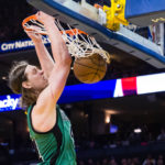 Boston's Kelly Olynyk (41) dunks the ball during Wednesday night's NBA game against Golden State at Oracle Arena in Oakland, California. The Celtics defeated the Warriors 99-86.