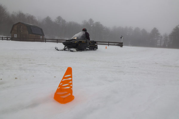 A participant in the Maine Becoming an Outdoors-Woman (BOW) Winter Skills Weekend learns how to safely drive a snowmobile on Feb. 25, at the University of Maine Bryant Pond 4-H Camp and Learning Center.