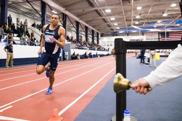 Isaiah Harris of Penn State takes the final lap bell as his team wins the men's 4x400 at University Park.