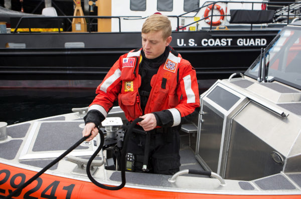 Fireman Joseph Jansen-Hedrick unties the bow of the 25-foot boat for a training exercise at the United States Coast Guard station in Rockland Friday. Cuts to the USCG proposed in Trump's budget would cripple the service in Maine.