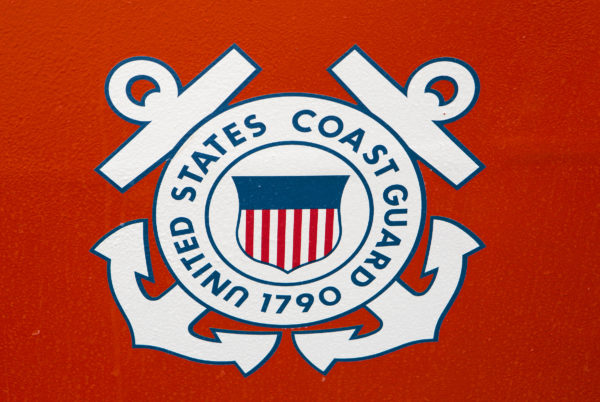 The United States Coast Guard seal is seen on the side of a vessel at the United States Coast Guard station in Rockland Friday. Cuts to the USCG proposed in Trump's budget would cripple the service in Maine.