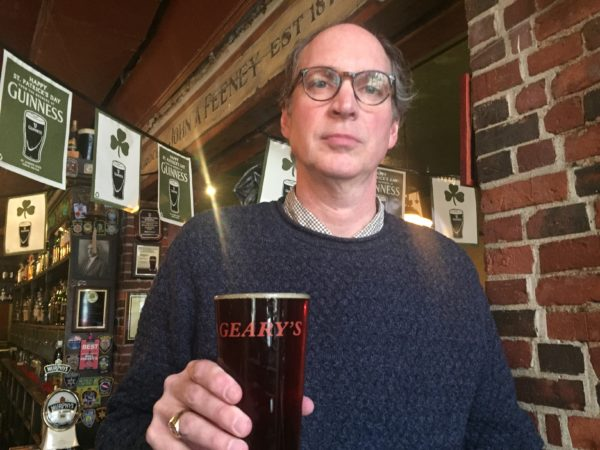 Doug Fuss, owner of Bull Feeney's stands with a pint of Geary's ale. He is selling them for $1 this weekend and when it's gone, it's gone.