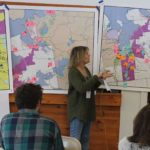 Moosehead Lake Cabins owner Sally Johnson goes over possible locations of improvements to downtown Greenville during a Moosehead Lake Regional Master Plan Future Think Tank on Thursday and Friday at the Bartley Facility.