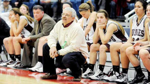 Craig Jipson (center), pictured during a game in February 2013, has stepped down after 12 seasons coaching the girls basketball team at Edward Little High School in Auburn.