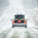 A snowblower hangs out the back of a car driving along Route 154 in Ripley as snow began to fall Tuesday afternoon.