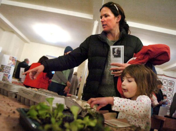 Bangor area residents examine the offerings at a community supported agriculture (CSA) fair in 2011.