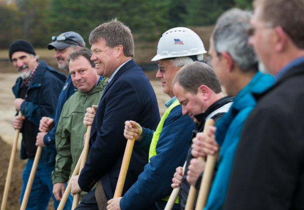 Municipal Review Committee Executive Director Greg Lounder (third from left), and Fiberight CEO Craig Stuart-Paul (center) stand among members of various companies involved in the development of the Fiberight municipal solid waste and recycling facility during the facility's groundbreaking ceremony in October 2016.