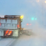A Bangor Public Works plow moves snow in Bangor late Tuesday.