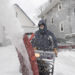 Eighty-year-old Ed Cyr uses a snowblower to clear his driveway at his Bangor home Wednesday following a late winter snow storm.