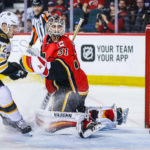 Calgary goalie Chad Johnson (31) reacts as Boston's David Backes (not pictured) scores a goal with Frank Vatrano on the doorstepp during the second period of Wednesday's NHL game at Scotiabank Saddledome in Calgary, Alberta. The Bruins won 5-2.
