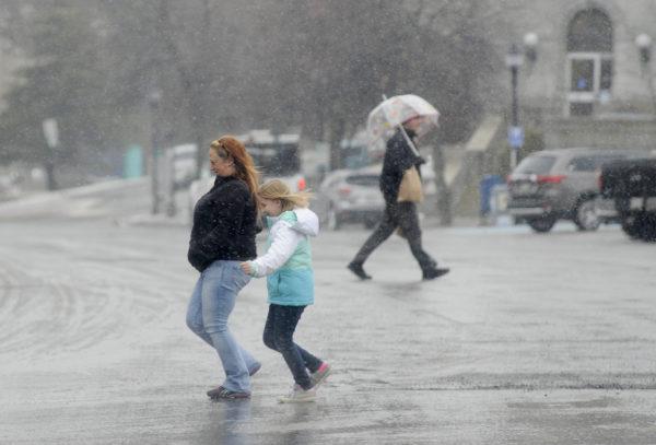 Pedestrians cross Harlow Street in Bangor.