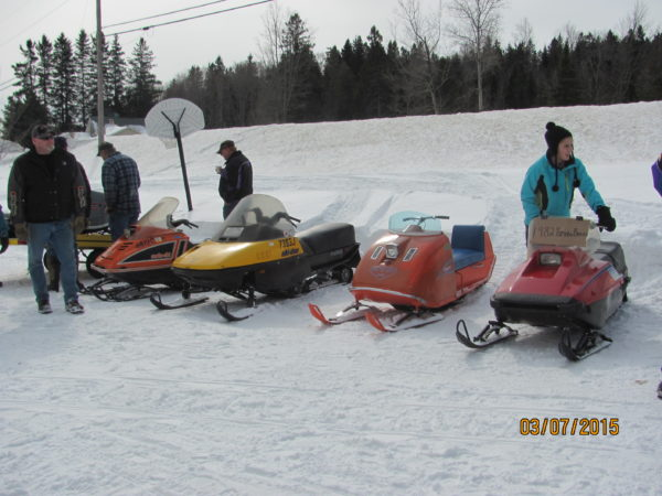 Older snowmobiles such as those pictured here at the 2015 Vintage Show and Ride in Smyrna Mills will be on the track this Saturday for the Penobscot Snowmobile Club's &quotSqueeze the Throttle Vintage Snowmobile Races&quot in Hermon.