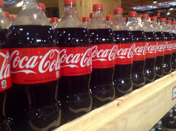 Two-liter Coke bottles on a shelf. Such bottles were under threat of no longer being included in Maine's deposit program.