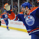 Edmonton's Milan Lucic (27) celebrates scoring goal against Boston during the second period of Thursday night's game at Rogers Place in Edmonton. The Oilers won 7-4.