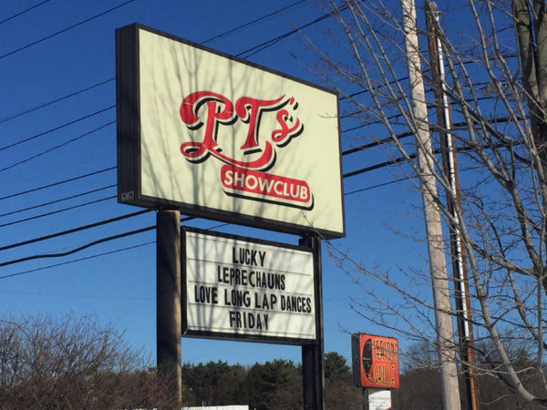 PT's Showclub, a strip club on Riverside Street in Portland, tries to lure customers in with its St. Patrick's Day sign on Friday. A lawsuit filed on March 10 is seeking class-action status on behalf of all the dancers against VCG Holding Corp., which owns PT.