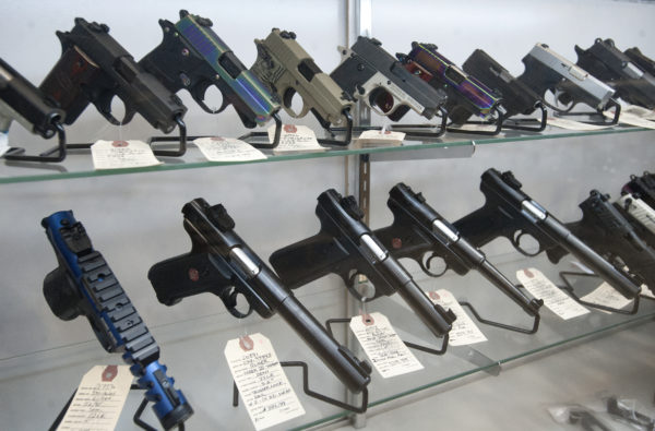 Handguns are offered for sale at Maine Military Supply in Holden.