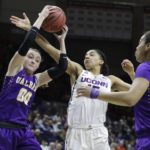 Albany's Mackenzie Trpcic (00) grabs a rebound against Connecticut's Gabby Williams (15) in the second half of Saturday's NCAA women's tournament at Harry A. Gampel Pavilion in Storrs, Connecticut. UConn defeated Albany 116-55.