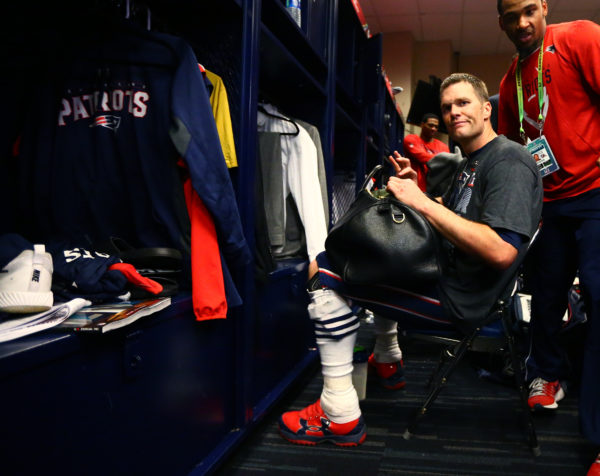 New England Patriots quarterback Tom Brady reacts in the locker room as he looks for his jersey after defeating the Atlanta Falcons during Super Bowl LI at NRG Stadium in Houston on Feb. 5. Brady's jersey, and the one he wore in the 2015 Super Bowl, were found in the possession of a Mexican journalist.