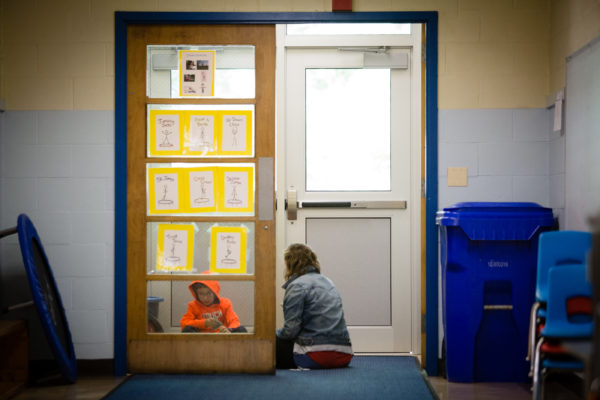 Student Quinn Coon works with a staff member in a makeshift teaching space at Harrison Lyseth Elementary School in Portland on Thursday. City government is considering funding renovations to Lyseth and other schools in the system.